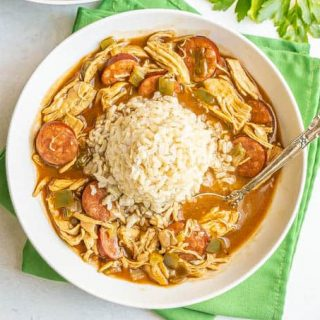 Chicken and sausage gumbo with rice in a wide, low bowl