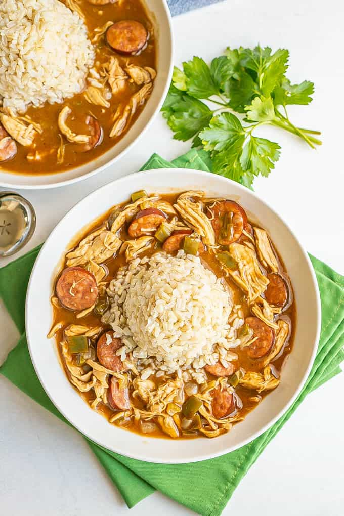 Chicken gumbo served in wide, low bowls with a pile of rice in the middle of the bowls