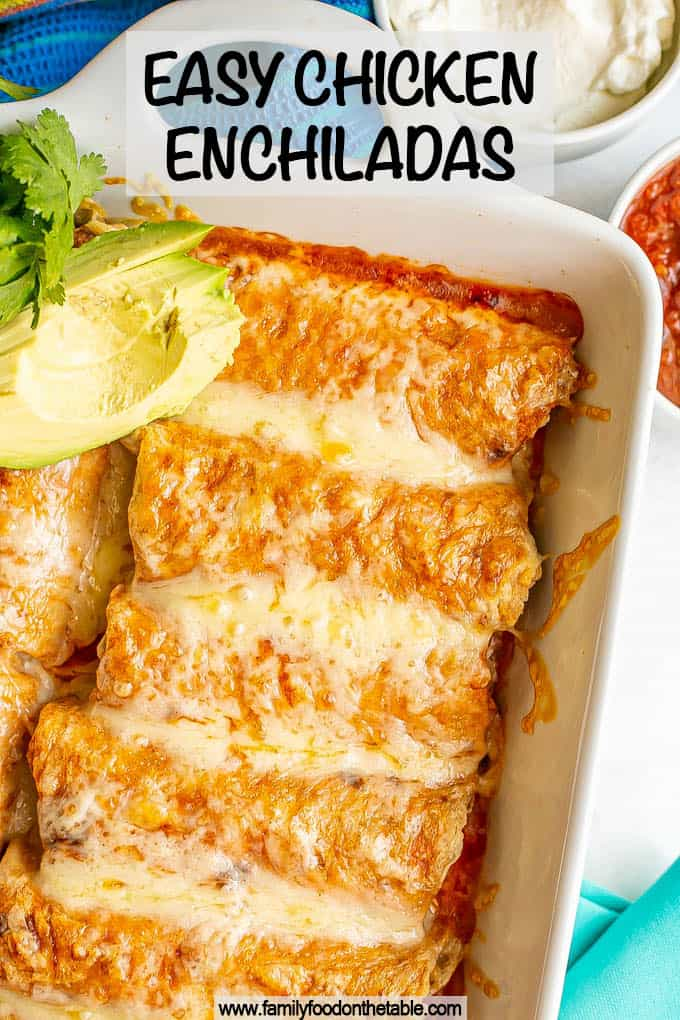 A white pan filled with cheesy chicken enchiladas with a text overlay on the photo