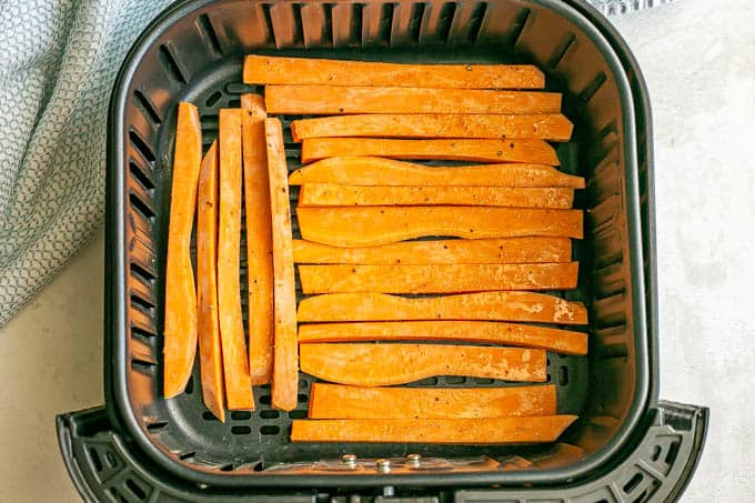 Sweet potato fries in an Air Fryer insert before being cooked