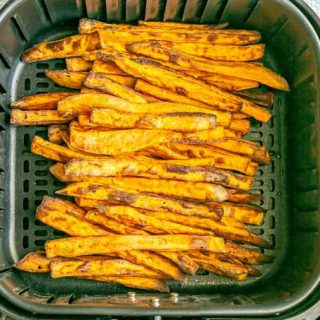 Sweet potato fries in the insert of an Air Fryer after being cooked