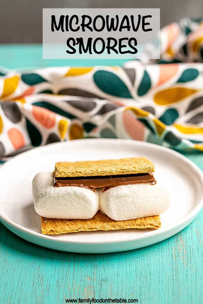 An individual smore on a small white plate with a text overlay of microwave s'mores on the photo