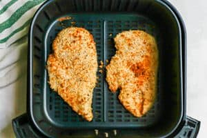 Breaded, browned chicken cutlets in an Air Fryer tray