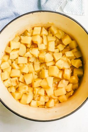 Tender chunks of potato in a large pot