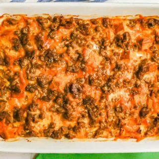 A baked breakfast casserole with sausage, egg, bread and cheese