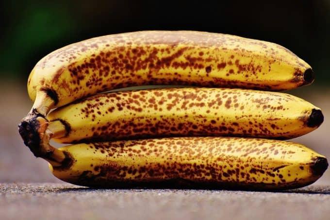 A trio of ripe bananas lying on their side